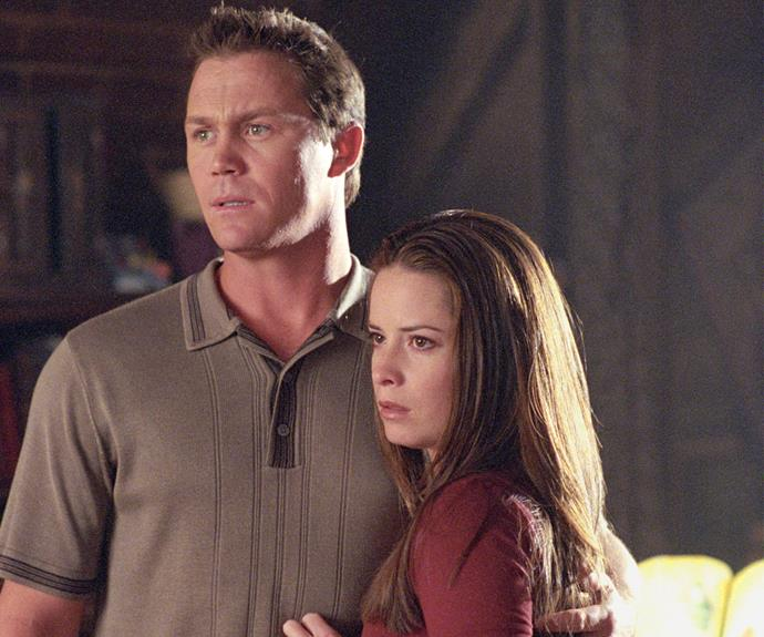 Holly Marie Combs with her *Charmed* co-star Brian Krause. The pair played married couple Leo and Piper.