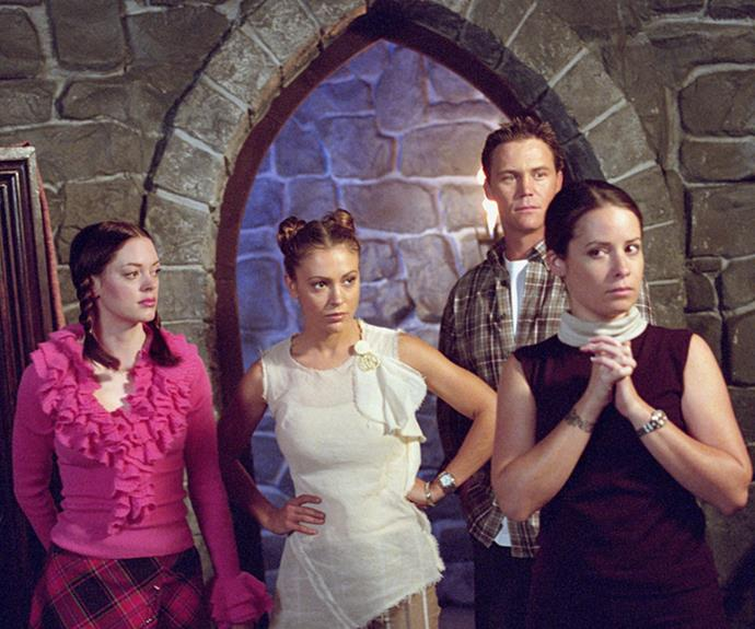 The Halliwell sisters - Paige, Phoebe and Piper - played by Rose McGowan, Alyssa Milano and Holly Marie Combs with co-star Brian Krause who played Whitelighter Leo.