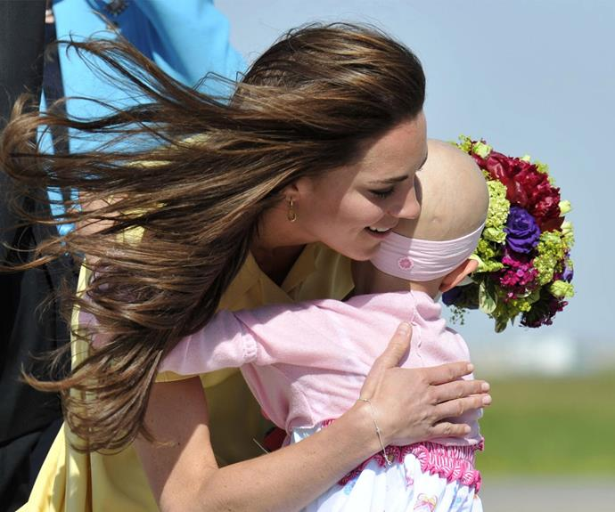 Who could forget this incredibly moving moment when cancer patient Diamond Marshall, who sadly died in 2014, greeted the Duchess with a bunch of flowers in Calgary, Canada during the 2011 royal tour. Clearly moved by the gesture, Kate wrapped her arms around the little girl.