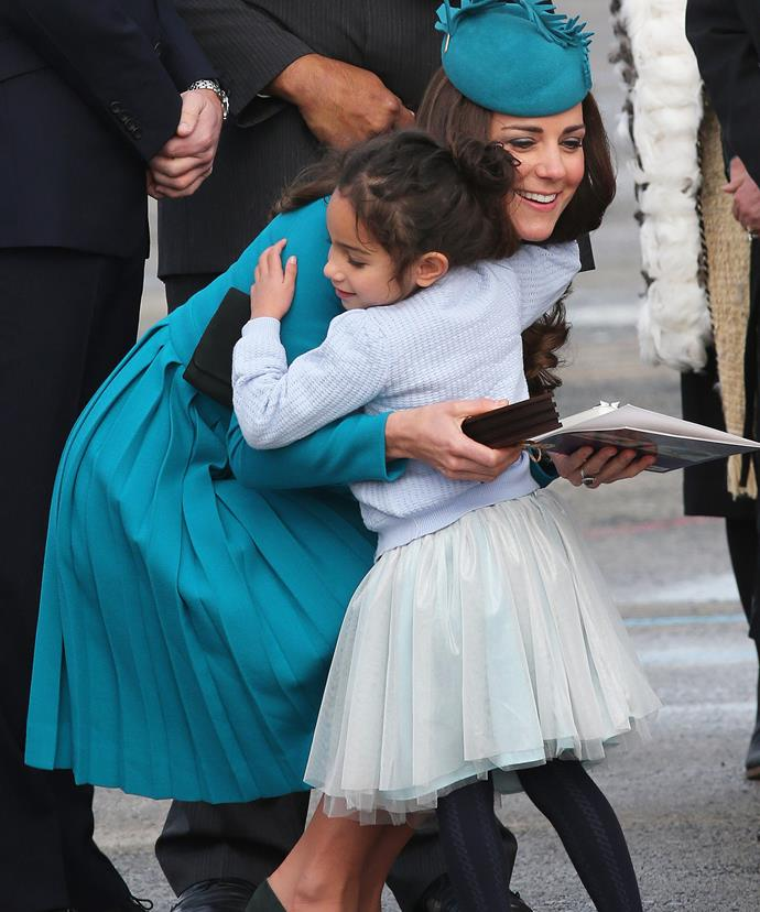 The look on Kate's face says it all - hugs are powerful! Here the Duchess meets with a fan at Dunedin, New Zealand in 2014.