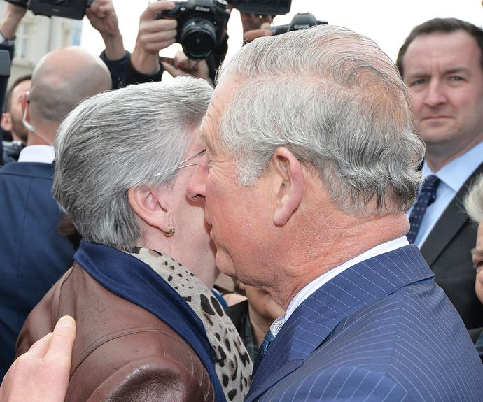 Prince Charles comforts a woman whose family members are still missing from the 1999 Kosovo war.