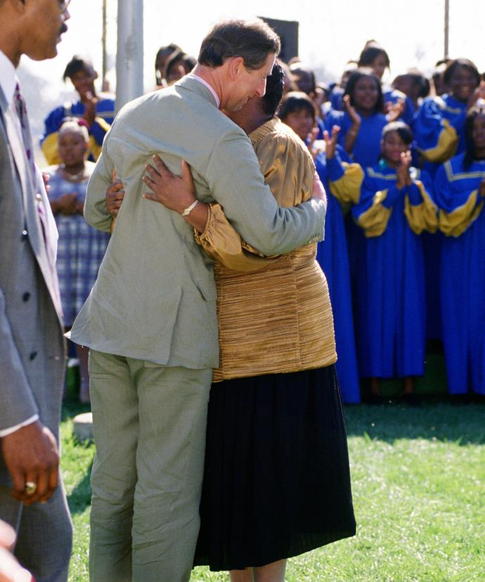 The Prince of Wales hugs a well wisher in LA in 1994.