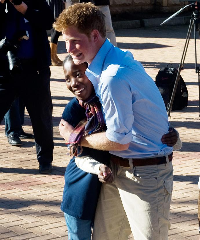 """Prince Harry is a *big* hugger and admits his """"naughty streak"""" helps him """"relate to those individuals who have got themselves into trouble."""""""
