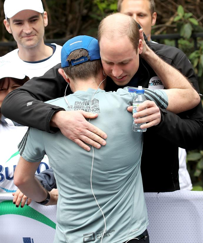 """Prince William hugs a runner at the end of the [London Marathon.](http://www.nowtolove.com.au/royals/british-royal-family/british-royal-family-london-marathon-2017-36939 target=""""_blank"""")"""