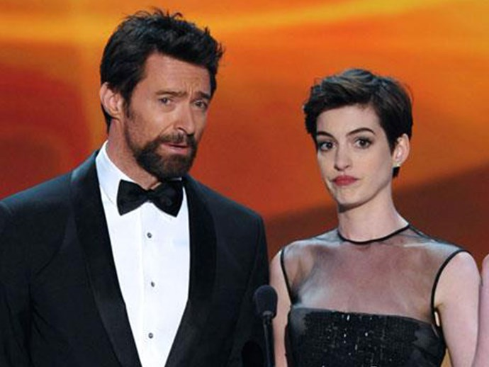 """When accepting her Oscar for best supporting actress in *Les Miserables*, Hugh was one of the first people Anne thanked. The pair first spoke at the 2011 Oscars and Hugh said he """"instantly"""" loved Anne when they met."""