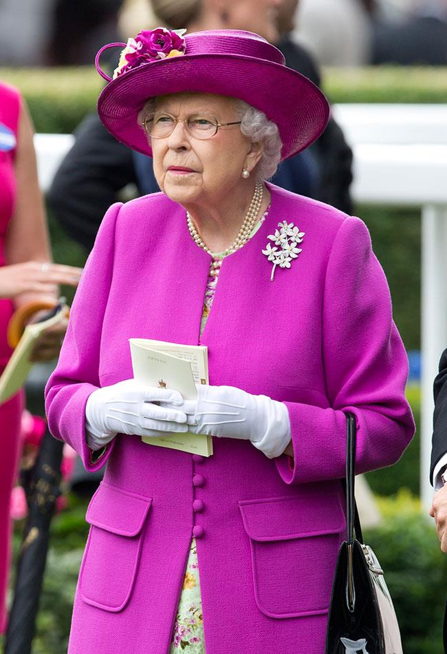 **6. Queen Elizabeth.** Can she do no wrong? This bold purple look could be difficult to pull off, but for The Queen, it's a breeze!