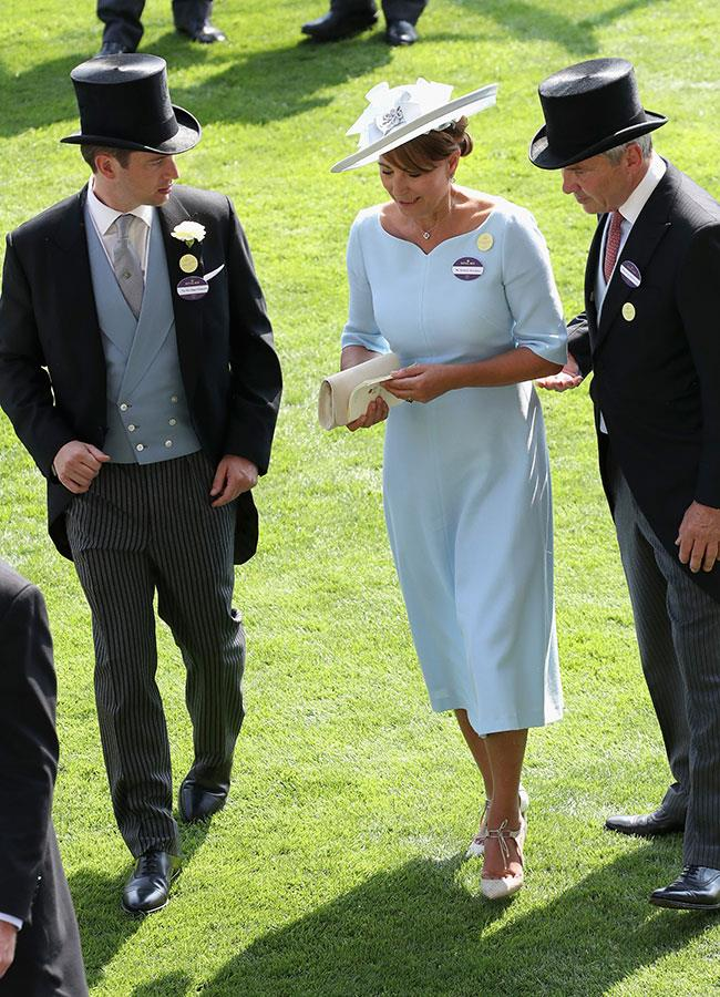 **5. Carole Middleton.** Kate's mother, Carole Middleton, 62, also joined the party looking every bit the royal in a sky blue dress by Goat.