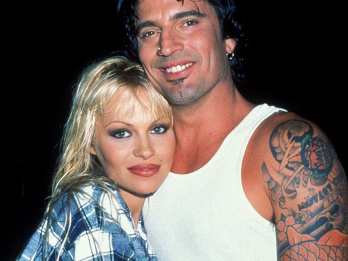 **1996:** Pamela met and wed Tommy Lee, drummer of band Mötley Crüe, early 1995 after knowing him for a mere four days. It was a rocky relationship that would last just three years, during which time they would welcome two sons - Brandon and Dylan. However these happier moments were marred by that infamous stolen sex tape, allegations of drug abuse and domestic violence. It was also during this tumultuous time that Pam would get her iconic barbed wire arm tattoo, something she'd later regret and remove.