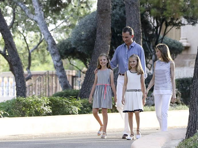 King Felipe VI and Queen Letizia of Spain take a stroll around Marivent Palace where they holiday each summer.
