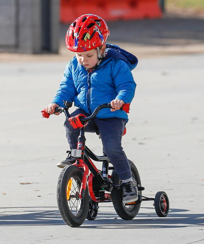 The three-year-old carefully pedaled along.
