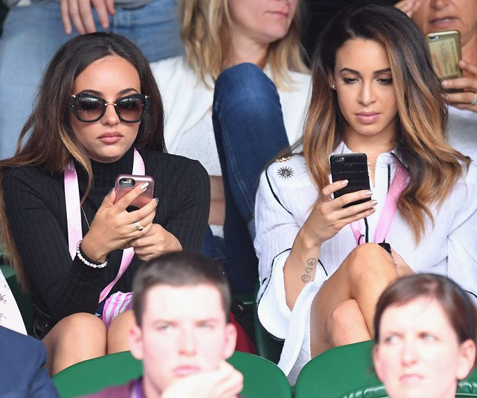 Some fans would give away their limb for tickets to Wimbledon so they best look away now! Yep, Jade Thirlwall from Little Mix (L) and a pal seemed more interested in their phones.