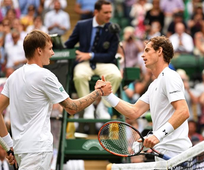 A gracious Andy Murray shakes Alexander Bublik's hand.