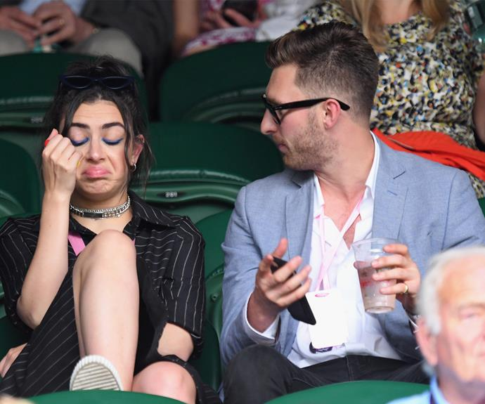 Charli XCX and a mate soak up the atmosphere.
