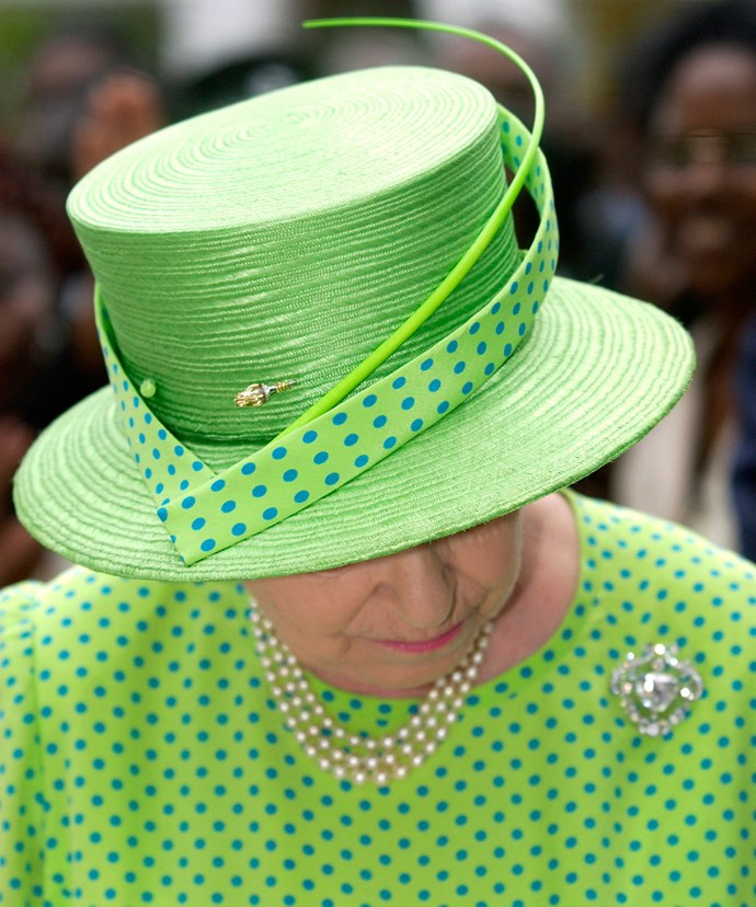 A close up look! Check out the incredible details on this guy, which she wore during an outing in London in 2002.