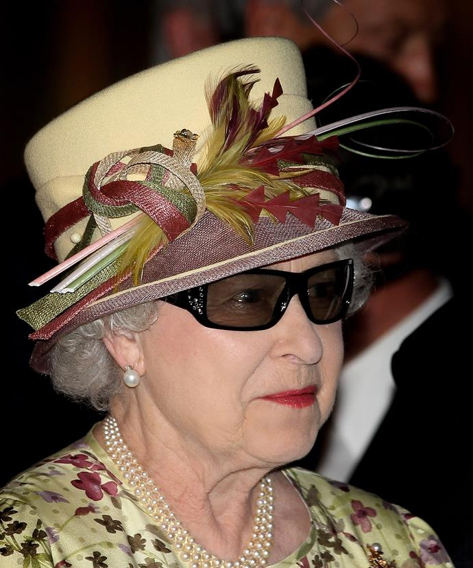A hat, pearls, rep lippie and sunnies? It's only a look this fearless ruler could pull off.