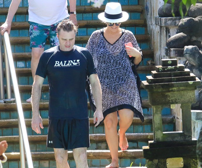 The actor kept sun-safe in a rash vest and board shorts while Fifi opted for a floaty kaftan.