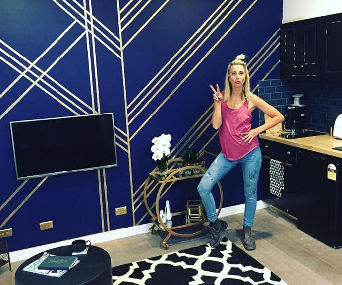 Daniella strikes a pose with her Art Deco wall.