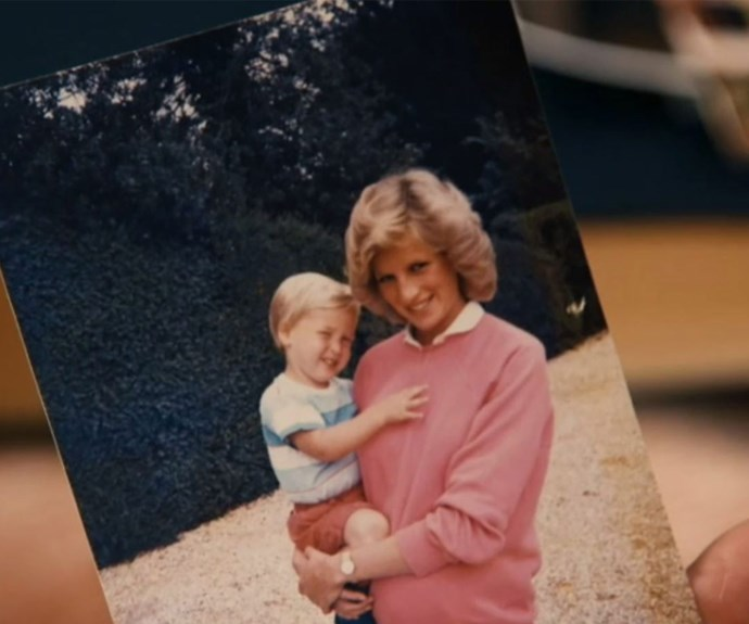 The royal brothers have shared this never-before-seen photo of a pregnant Diana holding a young Prince William. **(Image/ITV)**