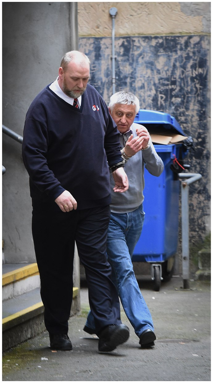 David being led away from court.