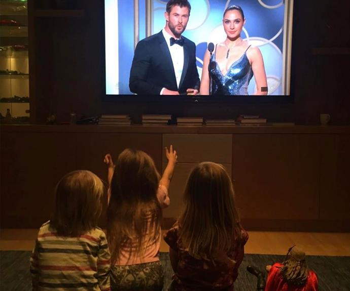 **Golden moment:**  When Chris presented an award at the Golden Globes this year, he uploaded a pic of his fan club (his three children AND a toy Thor) watching from home. It's a full-blown cuteness overload.