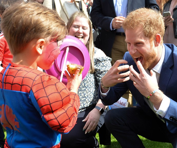 Indulging his inner *Spider-Man* during a garden party at Buckingham Palace in May. **Related video: the royal's best hugs. Post continues after!**