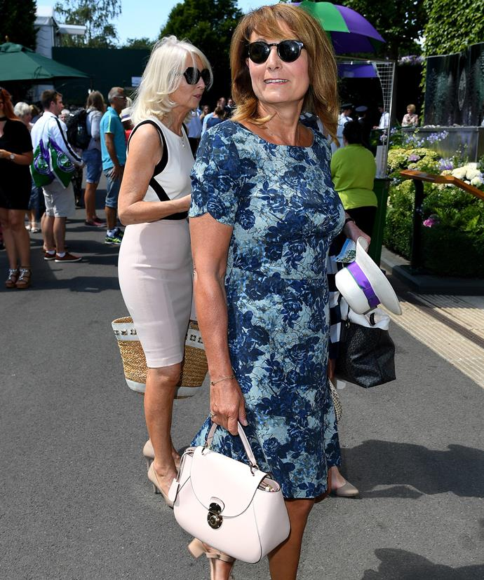 Meanwhile Carole looks classy in blue.