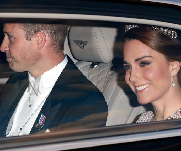 Kate topped off her elegant ensemble with the Cambridge Lover's Knot tiara - one of Princess Diana's favourites.