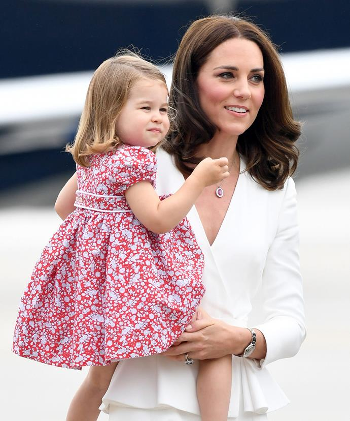 Kate looks fab in her trusted white McQueen.