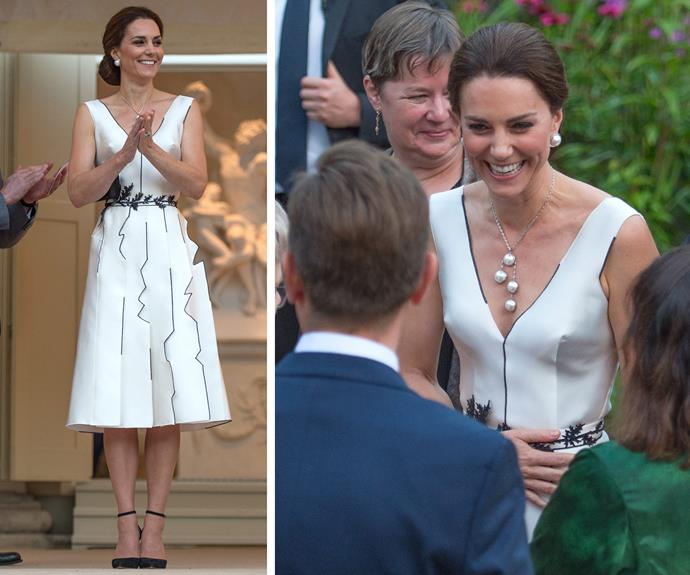 Kate wowed in a cream dress by local Polish designer, local Polish designer.