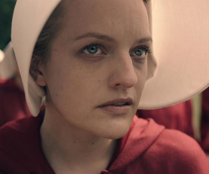 **Elisabeth Moss:** American actress Elisabeth plays the main character Offred in *The Handmaid's Tale*. Before she was forced to become a handmaid, Offred lived a happy life as June.