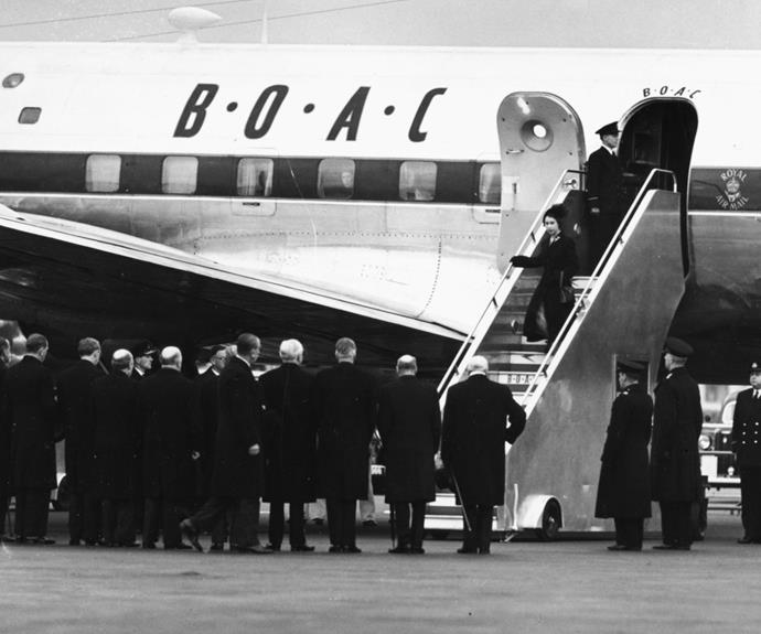 Queen Elizabeth and Prince Philip return from Kenya following the death of King George VI.