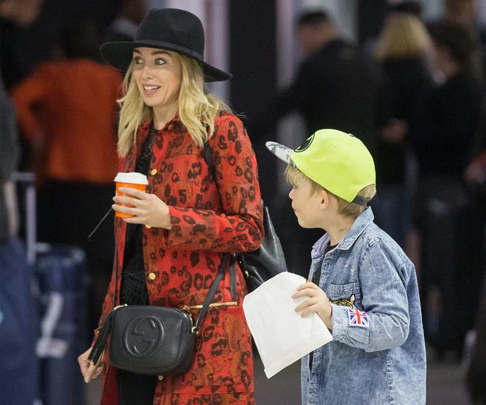 Dannii and her little guy were seen arriving into Melbourne airport.