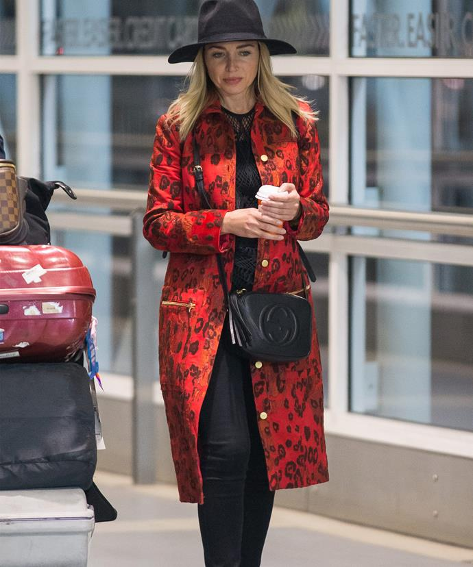 The Minogue queen gave us major airport fashion going for an all black ensemble featuring black jeans, black top, black hat, black shoes and a black Gucci handbag, breaking it up with a large bright red coat.