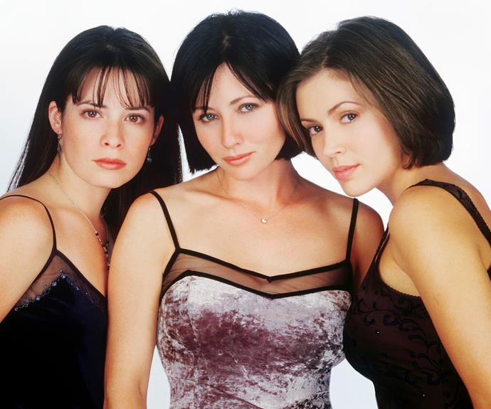 The original sisters of *Charmed* - Holly Marie Combs, Shannen Doherty and Alyssa Milano. Shannen's character was killed off and replaced by Rose McGowan.