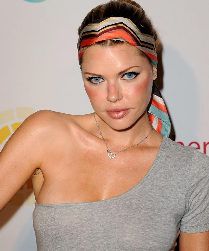Feeling rosy! The singer opts for flushed cheeks and a colourful headband as she attends a charity event in LA in 2011.