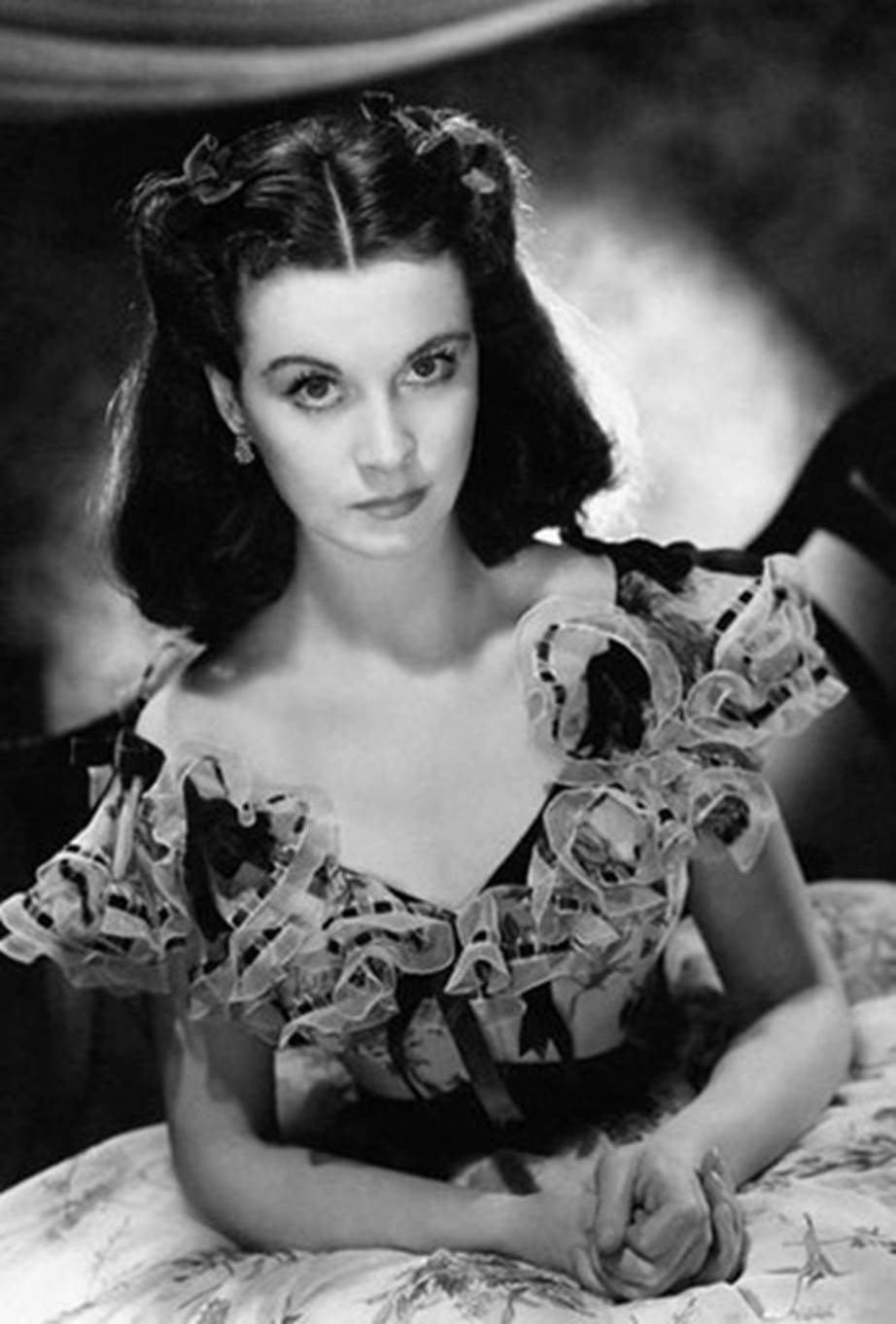 **Scarlett O'Hara, *Gone With The Wind***. Vivien Leigh's famous portrayal of Scarlett O'Hara in *Gone with the Wind* will forever be a classic. We adore the Southern belle look with rolled-back hair.