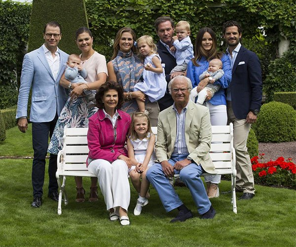 King Carl Gustaf and Queen Silvia of Sweden sit front and centre with their family.