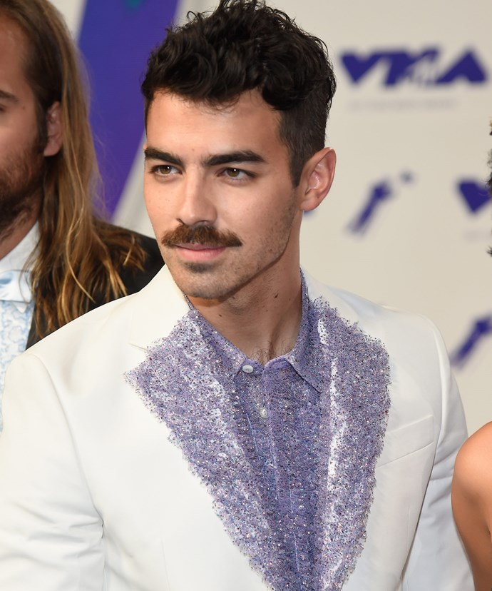 Joe Jonas and his mo decided to show off their best *Saturday Night Fever* impression.