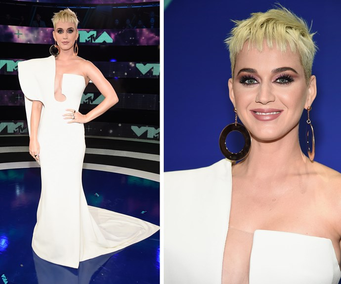 Tonight's host Katy Perry kicks off the evening with a stunning off-the-shoulder frock.