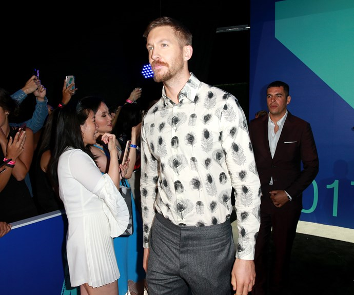 Calvin Harris walks right on in... Meanwhile his ex-girlfriend Taylor Swift may be a no-show but she shared an exclusive clip of her new song, *Look What You Made Me Do*. **Check it out in the next slide**.