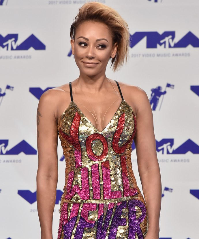 """In the midst of her high profile divorce, Mel B's stunning gown from Discount Universe sent a clear message with the words: """"You Will Never Own Me"""" emblazoned across it."""