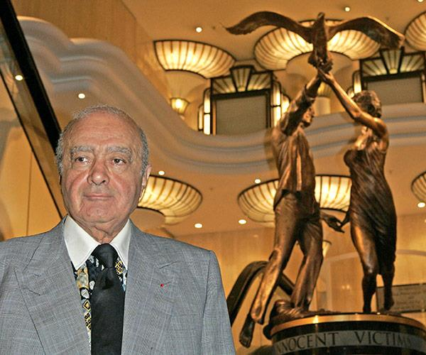 Mohamed Al-Fayed stands proudly next to the controversial statue of the couple.