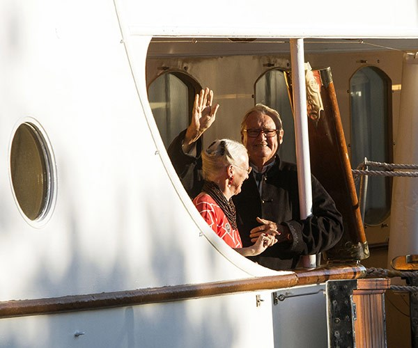 Prince Henrik gives a wave.