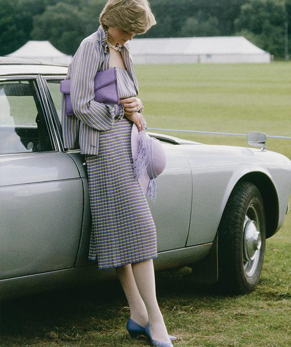 A month before her wedding, Diana takes a moment at a polo match in Windsor after the Ascot races, 16 June, 1981.