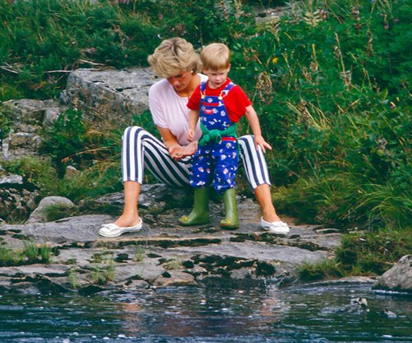 Diana with Harry playing on the banks of the River Dee, near Balmoral Castle, back in August 1987.