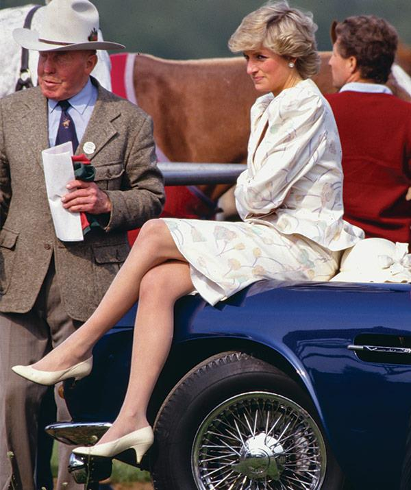 In 1987, Diana takes a second to enjoy the festivities at the polo.