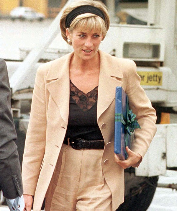 Airport chic! The Princess of Wales gets ready to make her way to New York in June 1997.