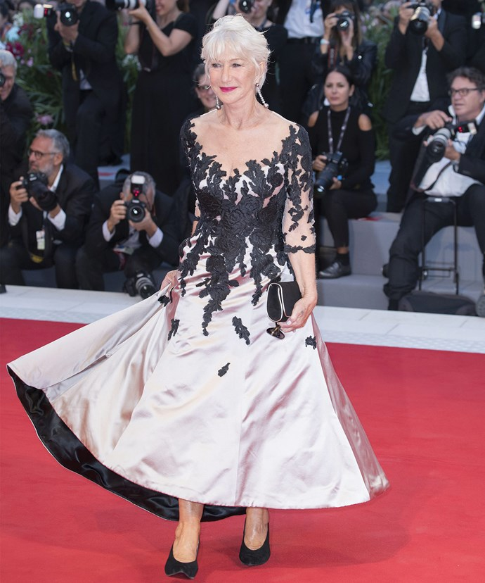 Helen Mirren twirls in a Sassi Holford sheer silver and floral gown.