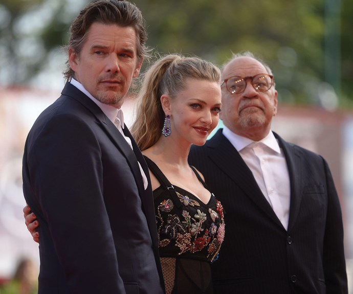 Actors Ethan Hawke and Amanda Seyfried with director Paul Schrader for the premiere of *First Reformed*.