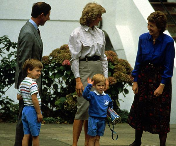 Harry gives the royal wave at the gates on his first day of nursery school in 1987.